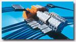 莫尔塑料是世界领先的标识系统生产商。她开发的ACS可用来标识单根电线电缆、软管、接线端子、按钮和各种电器元件。 通过使用雕刻机、打印机及其配套的ACS配件,莫尔塑料创造了一种全面而又个性化的标识模式。所有的标识牌都具有高品 质和长寿命的特点。它用途广泛,在欧洲尤其受到汽车和机车 制造业的青睐。