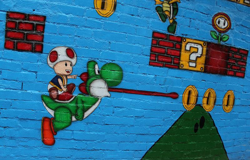 80年代回忆_北京dna街头涂鸦团队来到台中_使用涂鸦墙绘手法向游客们展示80后童年回忆墙体彩绘