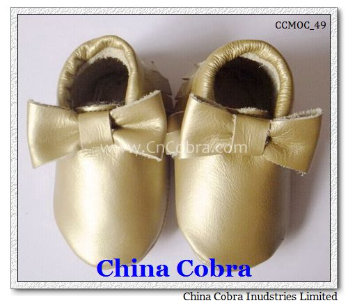 shiny gold bow moccasins